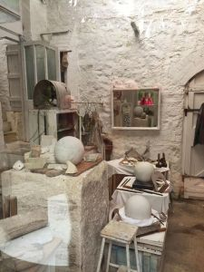 As writers we don't need all this stuff - so do it anywhere! Me, reflected in Barbara Hepworth's (very tidy) studio.